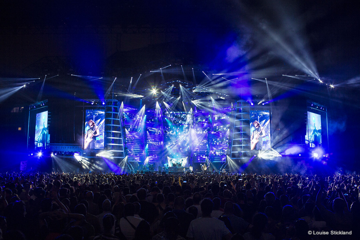 There are four large portrait IMAG video screens (two stage left and two stage right)